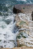 Big waves on rocky coast and blue sea royalty free stock photo