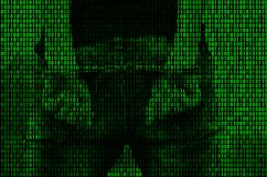 An image of a binary code from bright green figures, through which the image of an arrested and handcuffed person royalty free stock photo