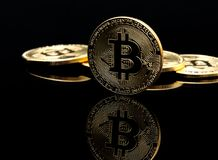 Bitcoin. Image of a Bitcoin on a black background Stock Image