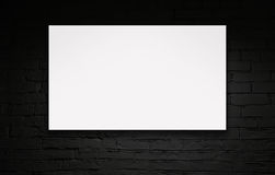 Image of blank billboard over black brick wall. Image of blank billboard over black wall Royalty Free Stock Photo