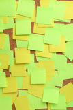 Image of blank colorful sticky notes on cork pinboard Stock Photo