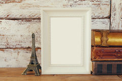 Image of blank wooden frame, next to old books Stock Photography