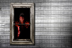 Image of Bleeding Woman in Window Stock Images