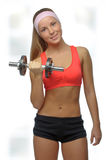 Image of blonde smiling woman with barbell in hand Royalty Free Stock Images