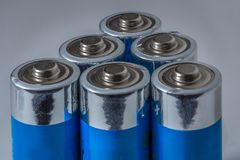 Blue AA Batteries on White Background Stock Photo
