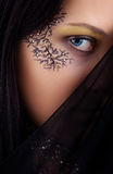 Image blue-eyed girl. With drawing on the face Stock Photography