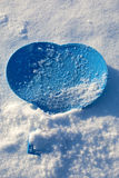 The image of the blue heart on snow Royalty Free Stock Image