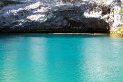 Image of blue lake and cavern Stock Image