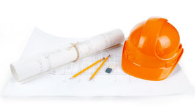 Image of blueprints with level pencil and hard hat on table Stock Photos