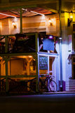 Image of blur cafe, near bike with night lights after sunset, blurred background, selective focus Royalty Free Stock Photo