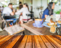 Image of blur outdoor restaurant on day time with green tree bok Stock Image