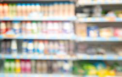 The image is blurred, and goods in the convenience store. And in the background With so many different products such as milk and of the need to refrigerate it royalty free stock photo