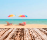 Image of blurred sea blue-sky colorful umbrella Royalty Free Stock Images