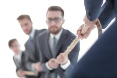 Image is blurred.the tug of war between business people. Closeup Royalty Free Stock Photography