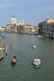 image of boats on a channel in Venice Stock Photography