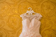Image of the bodice of a beige wedding dress on a hanger. Gown Royalty Free Stock Photo