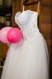 Image of the bodice of a weeding dress on a hanger Royalty Free Stock Photo