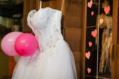Image of the bodice of a weeding dress on a hanger Stock Image
