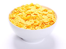 Image of bowl full of cornflakes over white Royalty Free Stock Photography