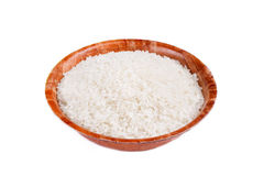 An image of a bowl with raw rice Stock Images