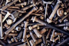 Nuts and bolts, long and short. new and old in all sorts and sizes. An image of a box of hardware. Nuts and bolts collected over a long period of time at a stock photography