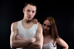 Image of boy with arms crossed and girl Stock Photos