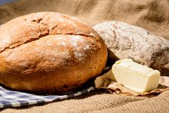 Image of bread loaf and butter Royalty Free Stock Images