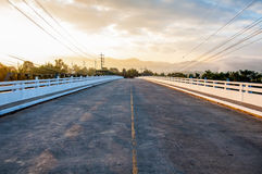 Image of bridge over the river at sunrise Royalty Free Stock Photos