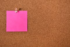 Sticky Note and Corkboard. An image of a bright sticky note pinned to a wooden cork-board stock photos