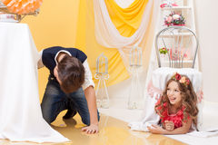 Image of brother and sister play hide-and-seek Stock Photography