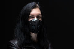Image of the brunet man in mask. On black background Stock Photo