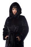 Image of brunette in black fur coat Royalty Free Stock Image
