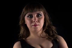 Image of brunette curvy woman. On black background royalty free stock image