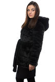 Image of brunette in fake fur coat with hood Royalty Free Stock Image