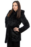 Image of brunette in fur coat with hood Stock Photos