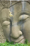 Image of buddha. Face image of buddha on the wall Stock Images