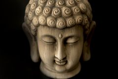 Image of the Buddha. On a background of a black color Stock Photos