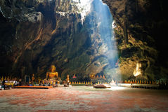 Image of buddha in the cave. That the light shine through , Thailand Royalty Free Stock Photo