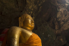 Image of Buddha in the cave. Big image of Buddha in the cave from Petchaburi, Thailand. Here is call Thum-Khao-Luang. Its have a big flue to let's the sun light Royalty Free Stock Photo