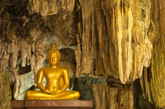 Image of buddha statue in the cave. Kanchanaburi province Thailand Royalty Free Stock Photo
