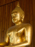 Image of buddha statue. On wooden wall background Stock Images