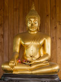 Image of buddha statue. On wooden wall background Stock Image
