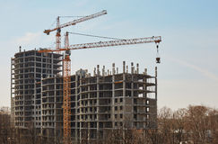 Image of building under construction and cranes Royalty Free Stock Photos