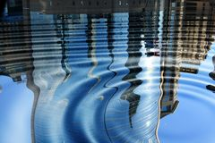 Buildings relecting in water. Image of buildings reflected in water, the image is distorted by ripples Stock Photography