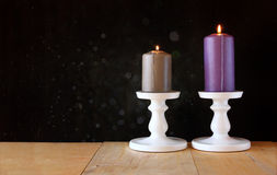 Image of Burning candle on wooden table and black textured background Royalty Free Stock Photography
