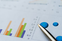 Image of business analysis, chart, graph, and pen Stock Image