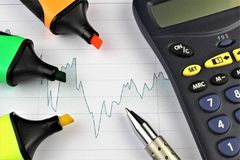 An image of a business concept with calculator and pen. Abstract Stock Photography