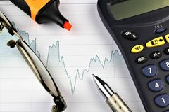 An image of a business concept with calculator, pen and glasses. Abstract Royalty Free Stock Images