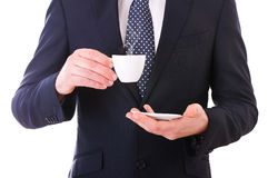 Business man holding cup of coffee. Royalty Free Stock Image