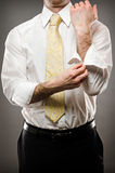 Rolling Sleeves. Image of a business man rolling up his sleeves Stock Photography